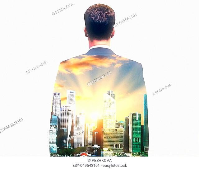 Back view of young businessman on abstract city background with sunlight. Double exposure
