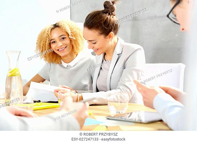 business meeting. portrait of a woman smiling at a meeting of a company