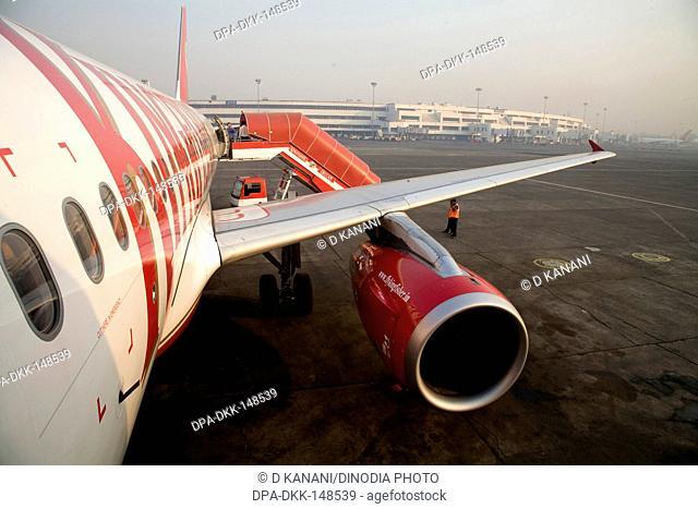 Kingfisher Deccan flight air bus A320 is ready to take off on Chattrapati Shivaji Terminal ; Santacruz ; Bombay now Mumbai ; Maharashtra ; India