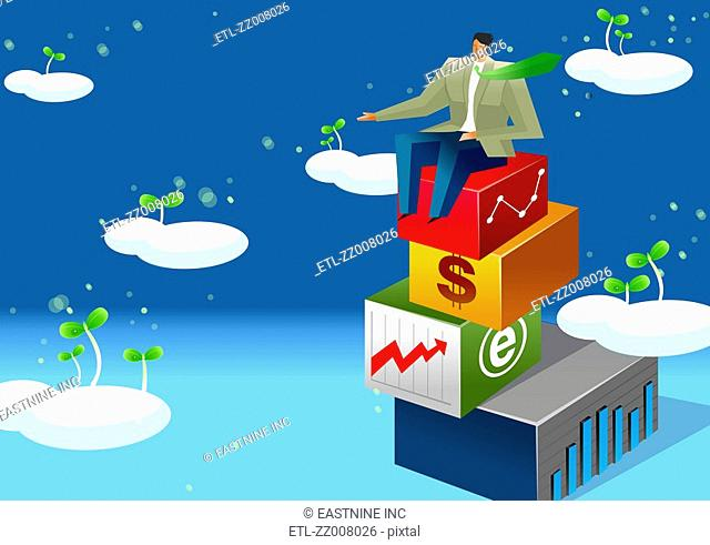 Businessman sitting on a stack of blocks with plants germinating from clouds