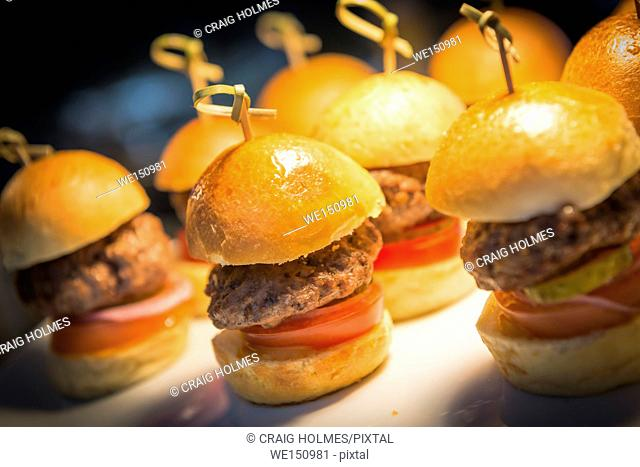 Burgers on a serving tray in a restaurant