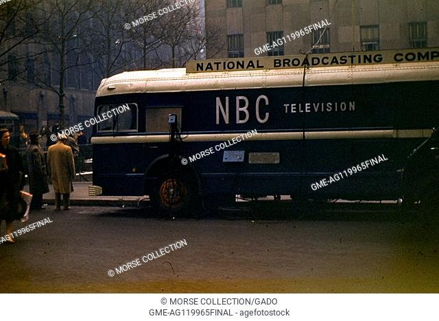 View of a National Broadcasting Company (NBC) television remote broadcasting bus parked outside Rockefeller Center Plaza, midtown Manhattan, New York City