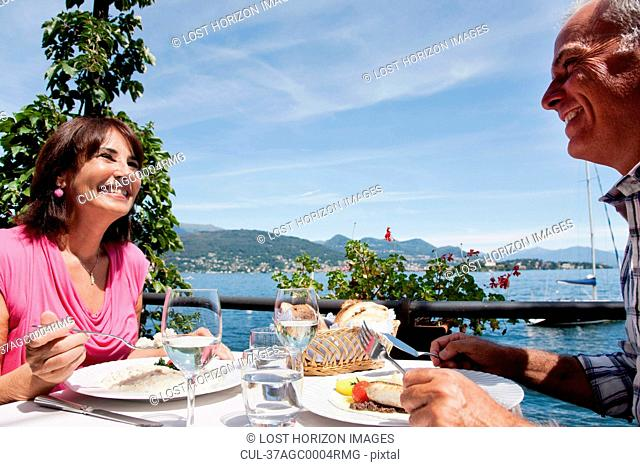 Older couple having lunch outdoors
