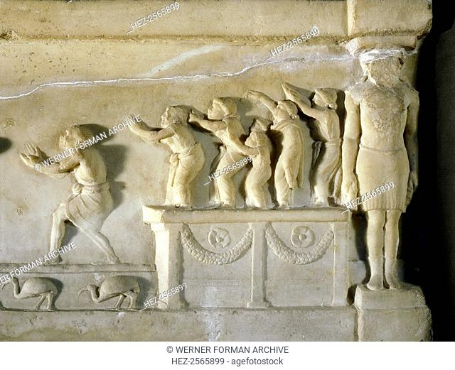 A relief found at Ariccia, south of Rome, which illustrates the celebration of religious rites in Egypt. Detail shows worshippers on a platform gesticulating in...