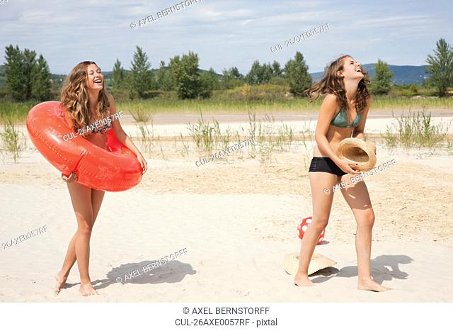 Young women laughing on the beach