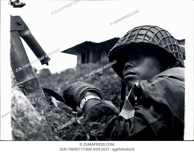 1956 - Typical Indonesian soldier walks for orders, his mother at his side. (Credit Image: © Keystone Pictures USA/ZUMAPRESS.com)