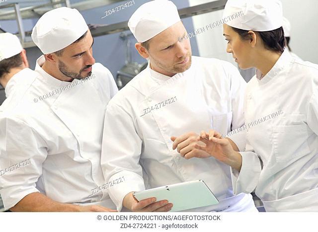 Restaurant kitchen workers talking