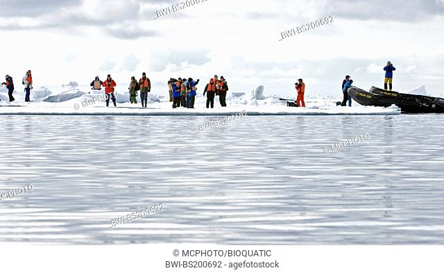 eco-tourists landing on pack ice at almost 80-degrees north during an Arctic expedition with the vessle Polar Star in June 2008, Norway, Svalbard