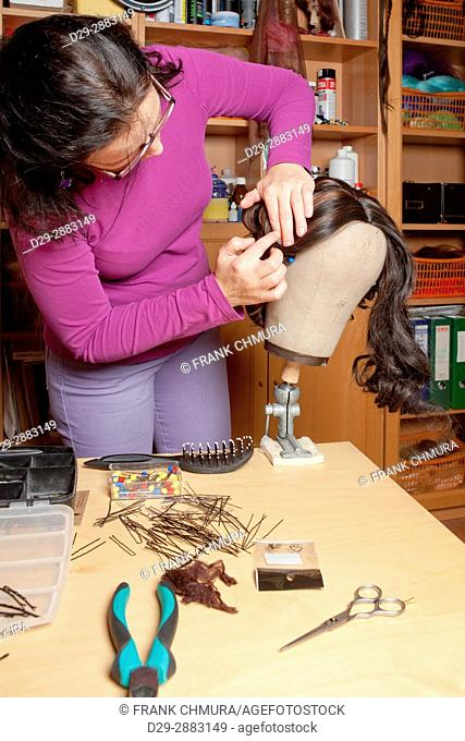 Professional Wig Maker Working in her Workshop