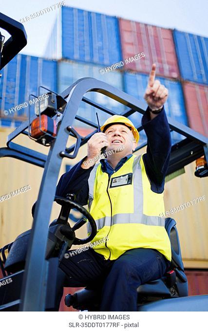 Worker using walkie talkie on site