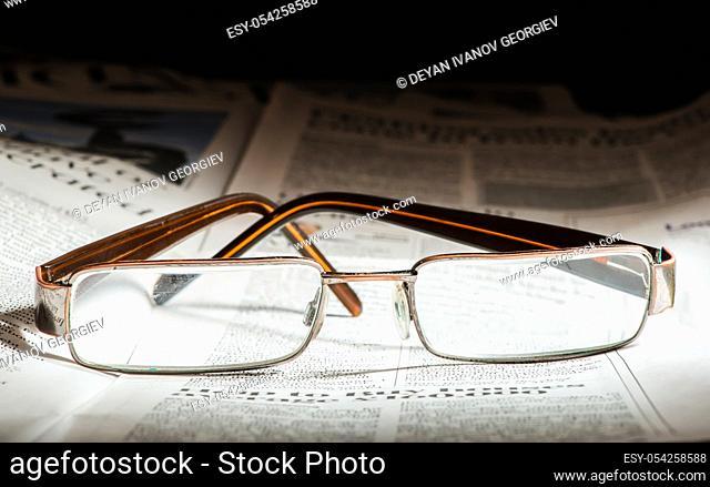Glasses on newspaper. Natural lightings