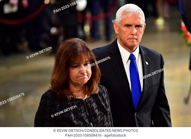 Vice President of the United States Mike Pence and wife Karen Pence view the casket of former Senator John McCain in the Capitol Rotunda where he will lie in...