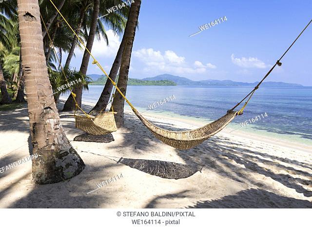 Hammock on tropical beach, white beach, near Port Barton, Palawan island, Philippines
