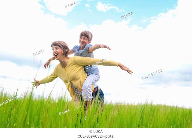 Mother with daughter pretending to be airplanes
