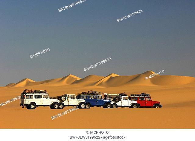 cross-country-vehicles in front of dunes in the White desert in evening light, Egypt, White Desert National Park