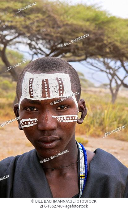 Tanzania Serengeti Africa Masai Maasai boys in black from circumcision ceremony with face paint and black clothes 7