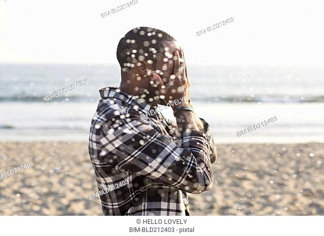 African American man playing on beach