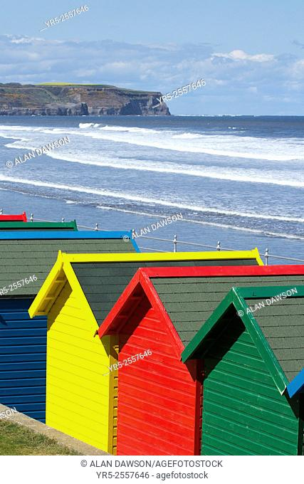 View over colourful beach huts at Whitby, North Yorkshire, England, United Kingdom.