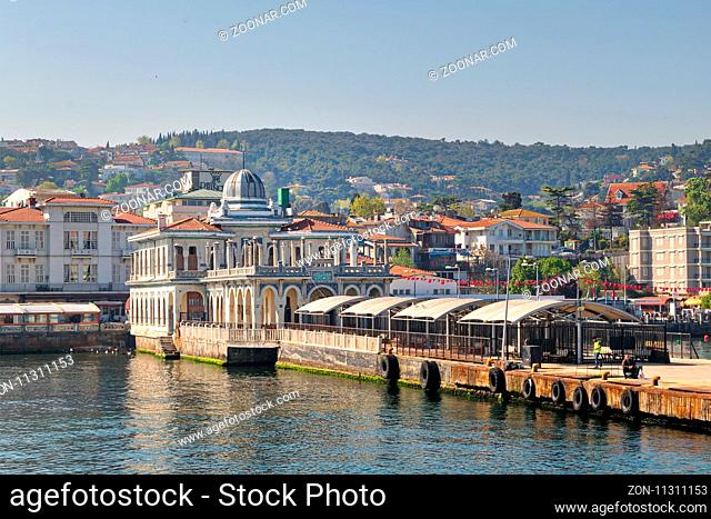 Istanbul, Turkey - April 27, 2017: Buyukada (Princess Island) Ferry Terminal with passengers riding a ferry and summer houses