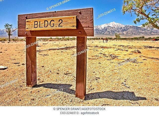 Mt. Williamson in the Sierra Nevada range is seen behind a sign marking the location of a barrack at the Manzanar prison camp outside Lone Pine, CA