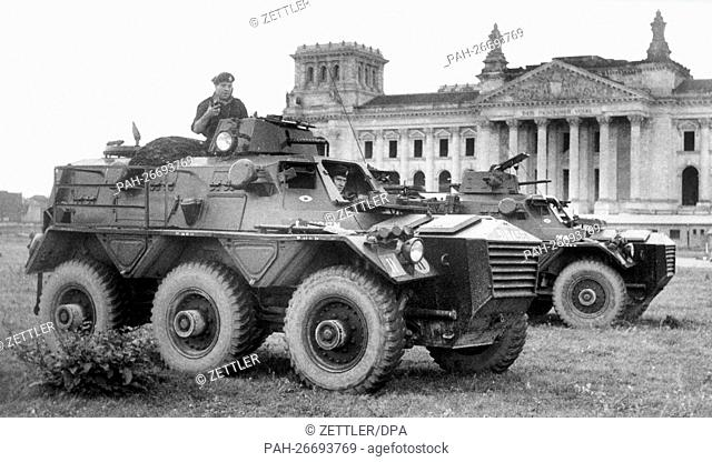 British armored reconnaissance vehicles take their positions in front of the Berlin Reichstag building near Brandenburg Gate on 23rd August 1961