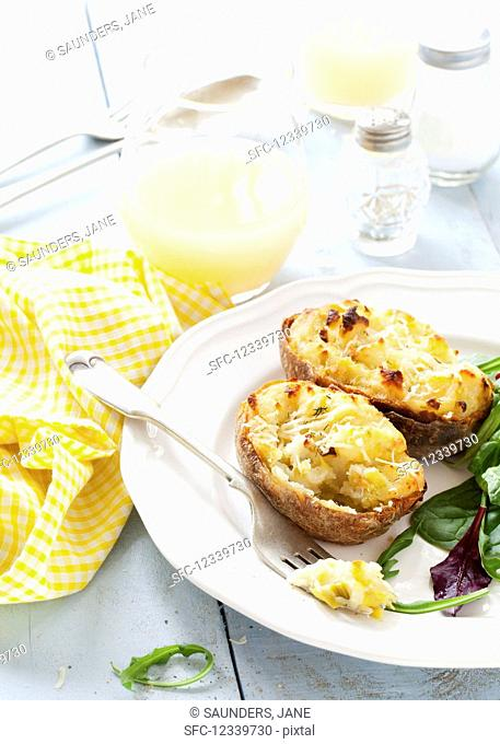 Baked Potato halves filled with cheese and leeks