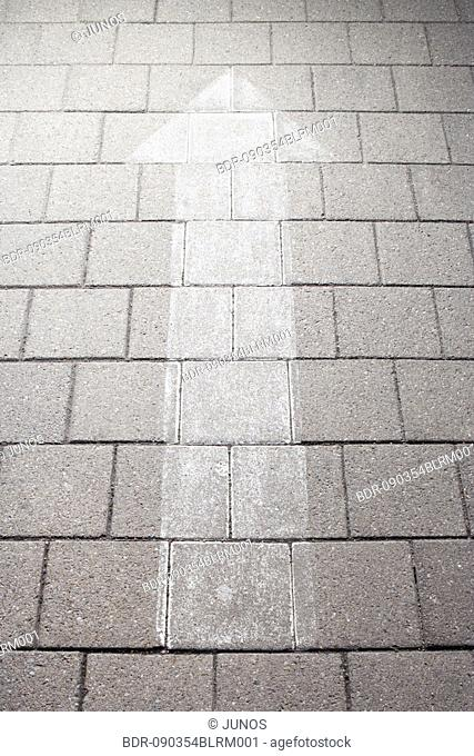 arrow painted on pavement