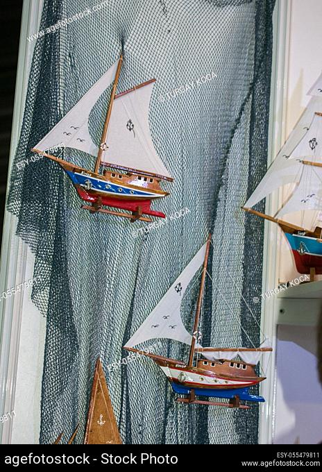 Set of small colorful model sailboats