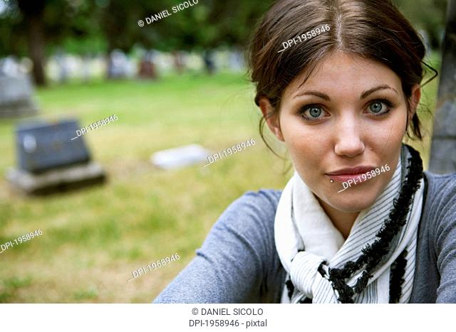 Portrait Of A Young Woman In A Cemetery; Edmonton, Alberta, Canada
