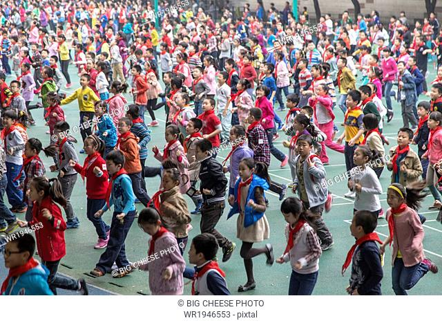 Children do morning exercise at a Chinese primary school