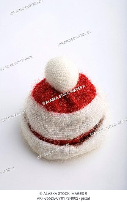 Closeup of one vintage knit Santa Claus hat with two thick brims on white background studio portrait