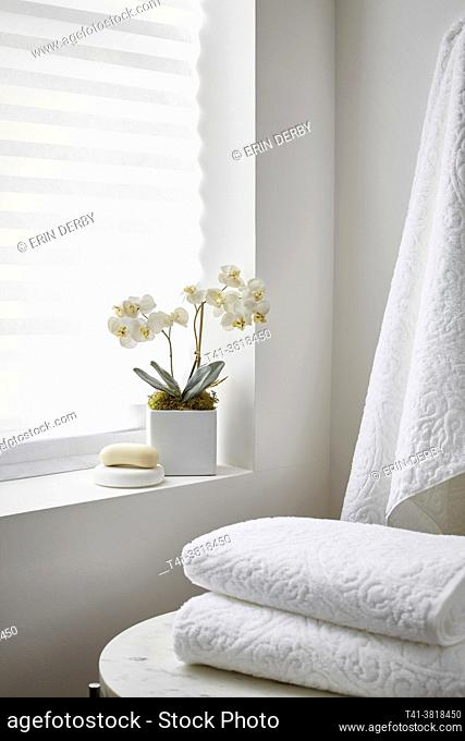 A stack of white towels in a spa-like setting