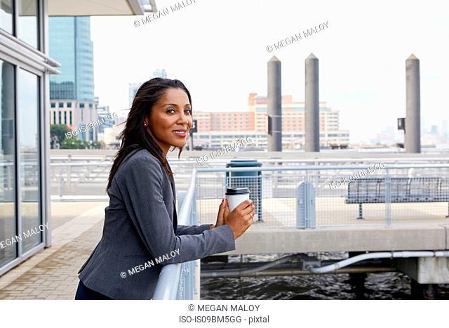 Businesswoman taking coffee break