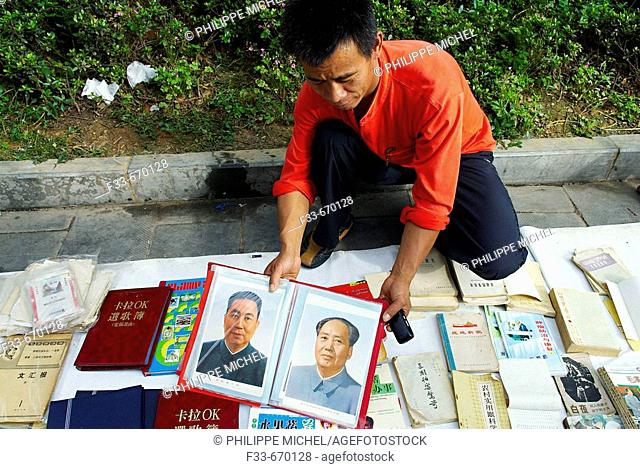 China. Guizhou province. Guiyang (capital city of the province). Renmin square. Book and pictures of Mao