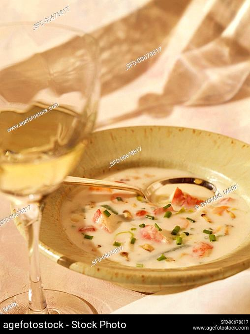 Bowl of Lobster Bisque with a Glass of White Wine