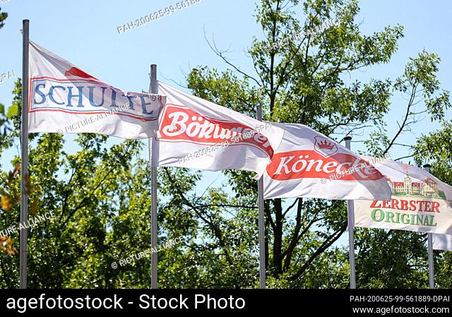 25 June 2020, Lower Saxony, Dissen: Flags of the companies Schulte, Böklunder, Könecke and Zerbster Original, which belong to the Tönnies Group