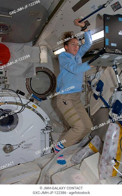Astronaut Sandra Magnus, Expedition 18 flight engineer, uses a computer in the Kibo laboratory of the International Space Station