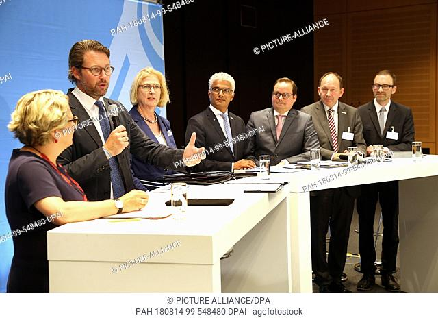 14 August 2018, Berlin, Germany: Svenja Schulze (SPD, l-r), Federal Environment Minister, Andreas Scheuer (CSU), Federal Minister of Transport, Ulrike Holst