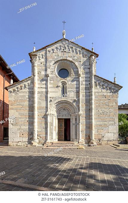 polychrome marble facade of Romanesque church in village on shore of Garda lake, shot in bright fall light at Toscolano-Maderno, Brescia, Italy