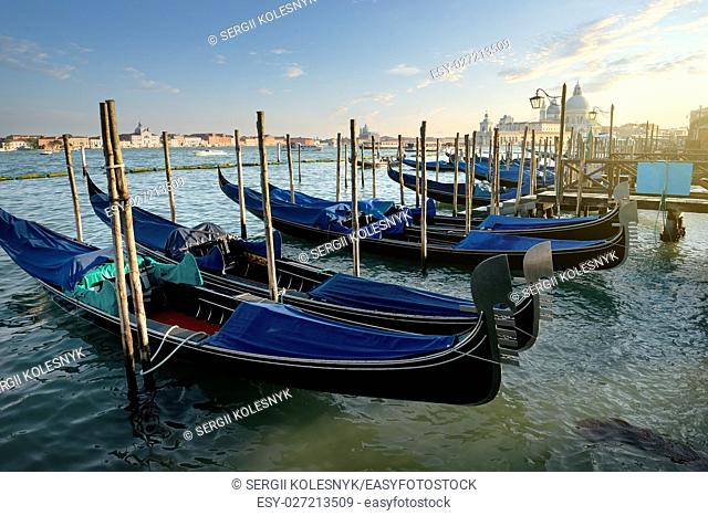 Venetian gondolas on Canal Grande in Venice at sunset, Italy
