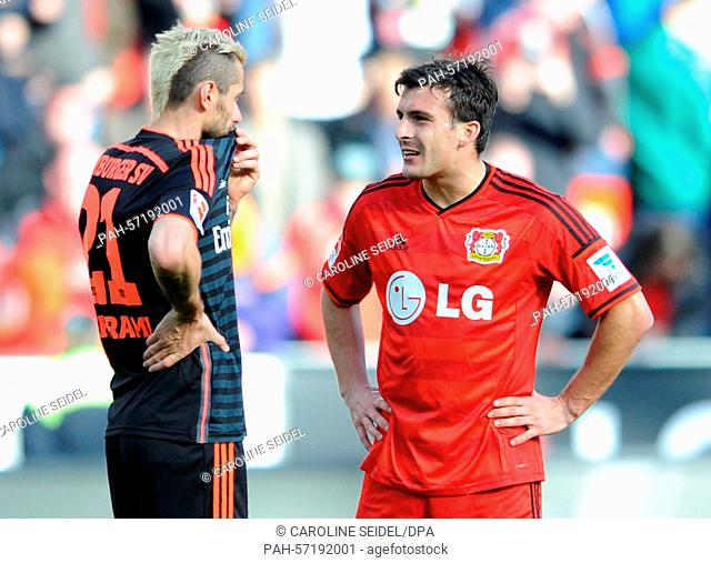 Leverkusen's Giulio Donati (r) and Hamburg's Valon Behrami (l) in conversation during the German Bundesliga soccer match between Bayer Leverkusen and Hamburger...