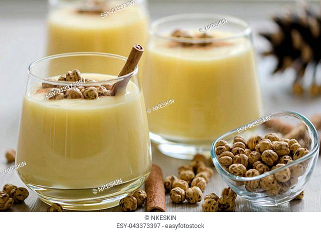Boza or Bosa, traditional Turkish drink with roasted chickpeas and cinnamon on the table. top view
