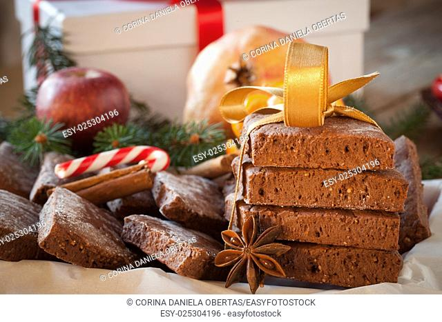Cookies, candy can and winter fruits, traditional Christmas background