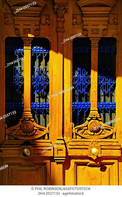 Madrid, Spain. Detail of yellow doors with blue iron work
