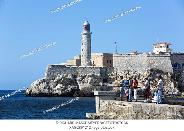 Local Fishermen on the Malecon, Morro Fortress with Lighthouse (background), Havana, Cuba