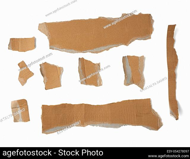 pieces of cardboard corrugated paper torn edges on a white background, abstract backdrop. Ripped paper texture