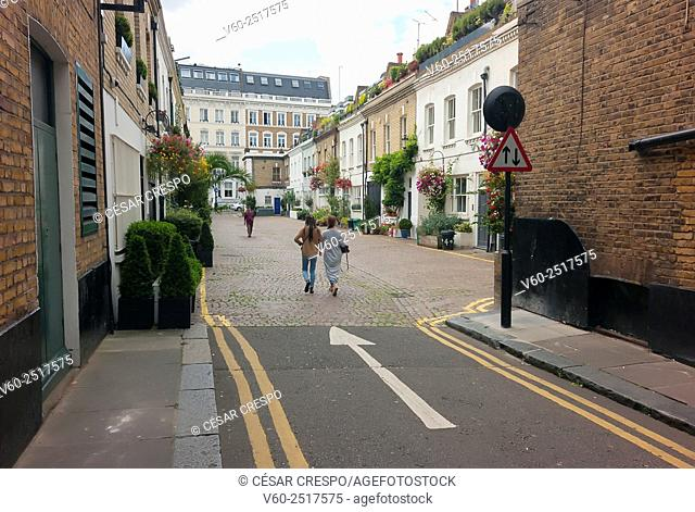 -Woman walking in Earl's Court- London United Kingdom