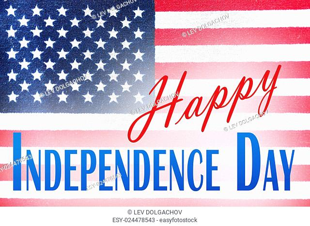 anniversary, celebration, patriotism and holidays concept - close up of american flag with happy independence day words