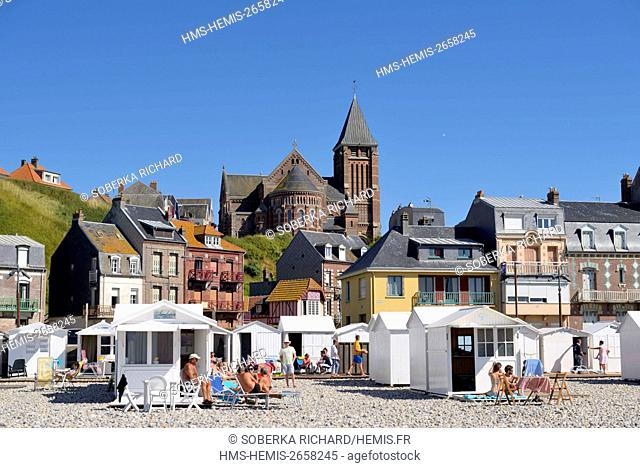 France, Somme, Mers les Bains, beach and cabins dominated by the Church of Saint Martin of Romanesque Byzantine style built in 1928
