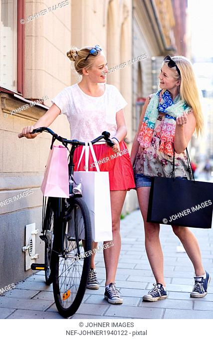 Young women with shopping bags, Stockholm, Sweden